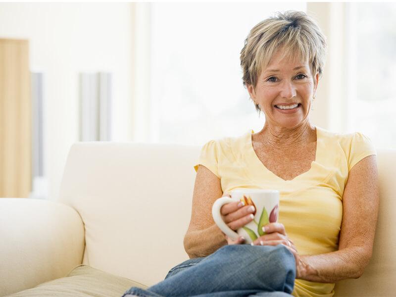 Woman Smiling After Bridgework Treatment
