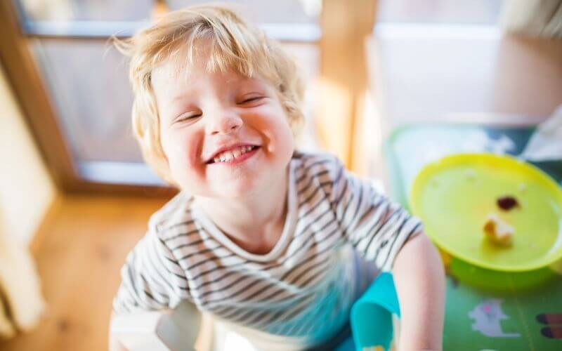 toddler smiling showing teeth