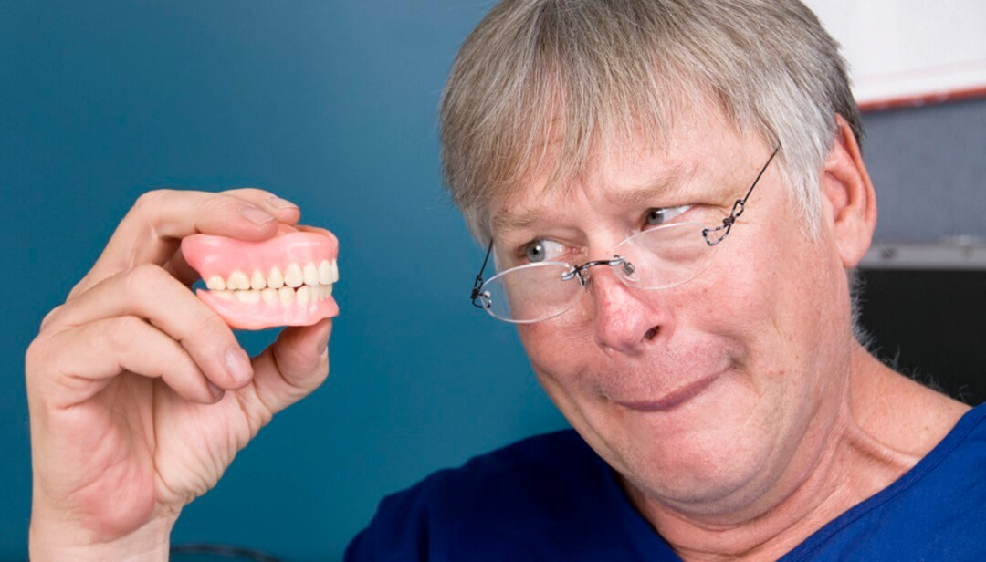 Man with his new dentures